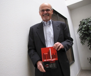Roy Osing posing with his book, BE DiFFERENT or be dead