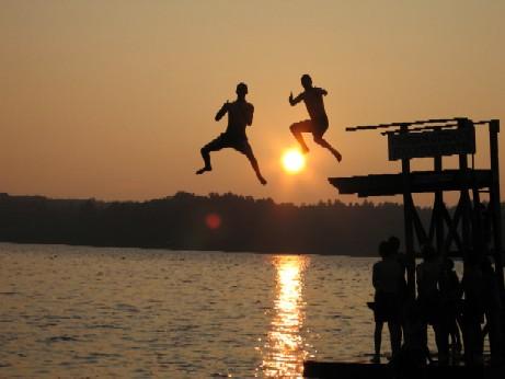 kids diving off a dock