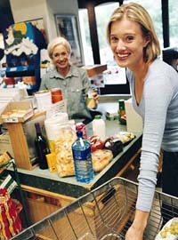 Woman standing at the grocery checkout